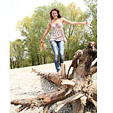 Young woman, Tree trunk, Balance