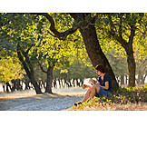 Woman, Nature, Reading