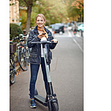 Woman, Smart phone, Electric scooter