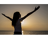 Girl, Sunset, Arms Outstretched