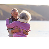 Happy, Embracing, Multicultural, Older Couple