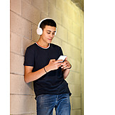 Teenager, Smiling, Typing, Headphones, Smart Phone, Listening Music
